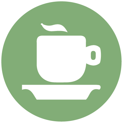 White coffee cup with a saucer on a green background
